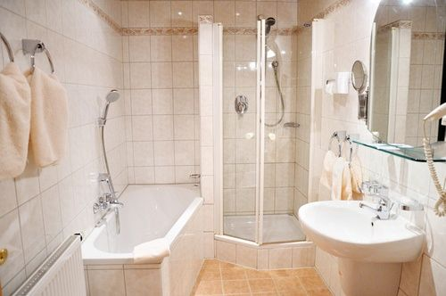 Average Cost To Install A Ceramic Tile Shower Stall Is About 2 620 3 Wall Shower Installed With Mid Gra In 2020 Shower Tile Shower Wall Panels Diy Interior Furniture
