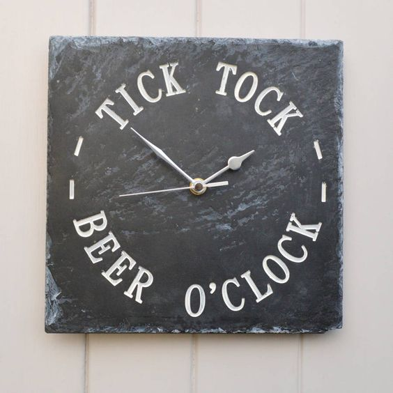 Our striking engraved slate clock has the fun words 'Tick Tock Beer O'Clock' engraved deeply into the slate.The clock is our own design and made in our workshop in Derbyshire using high quality materials and a good quality silent clock mechanism. Once we have engraved the wording deeply into the slate, we add a colour wash which is unique to us using colour pigment and natural oils and waxes to emphasise the wording and bring out the grain and colour of the slate. Our clocks are fitted with…