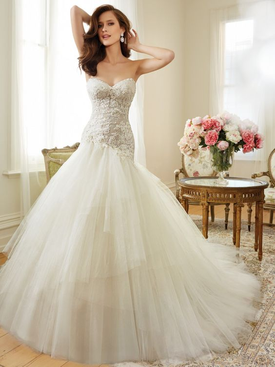 Sophia Tolli - Y11560 – Ibis - Tulle a line wedding dress with corset back, a modern day siren is captured in this misty tulle and lace full A-line gown with an asymmetrically dropped waist. Ibis also features a strapless sweetheart neckline with gently draped tulle framed by sparkling hand-beaded lace appliqués. Layers of asymmetrically placed tiers in shimmering misty tulle create an ethereal skirt with chapel length train.