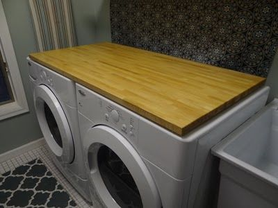 Placing a counter top on top of the washer and drier makes an easy place to fold right out of the drier!