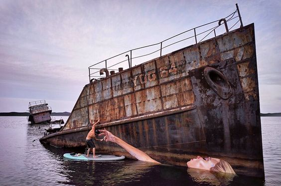 after finding an old sunken ship off the hawaiian coast artist sean yoro  aka hula  painted a a hyper-realistic portrait of a half-submerged female figure onto the dilapidated vessel as a permanent aquatic #artwork.  see more images of hoi mai online at #designboom.com by designboom