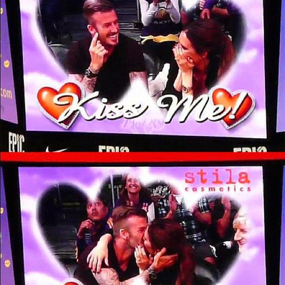 "David and Victoria Beckham on the ""kiss cam"" at Laker's game"