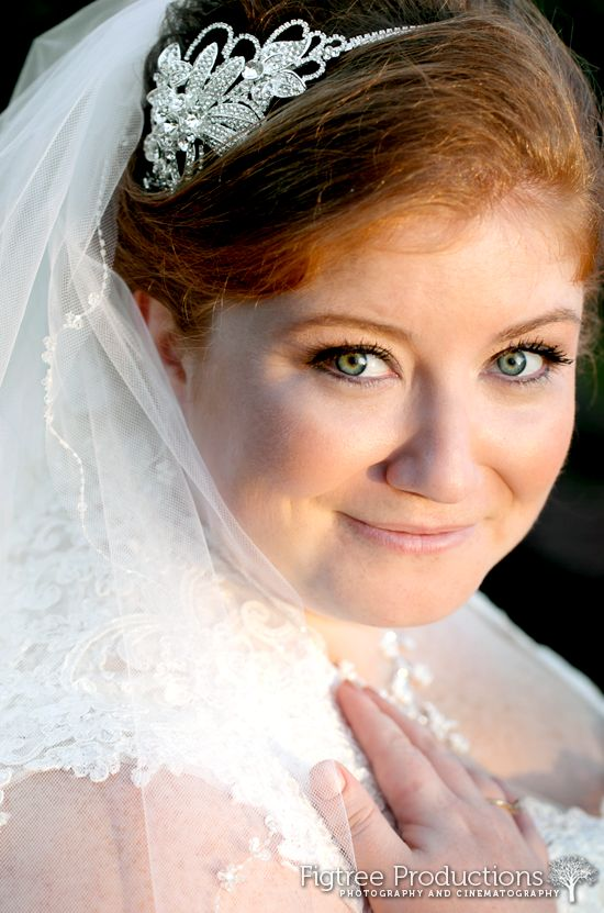 This bride's makeup enhanced her stunning green eyes.  Photographed by Figtree Productions