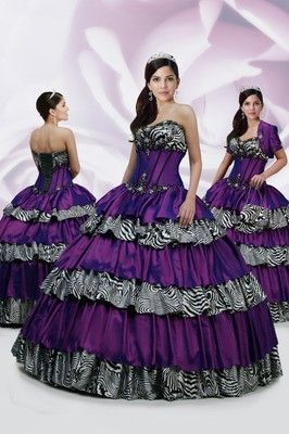 Quinceanera Dress #80066 Taffeta corset bodice with contrast piping accented with zebra print charmeuse. Embroidered waistline and a full horizontally layered taffeta and zebra print skirt. Lace up back. Includes jacket and purse.