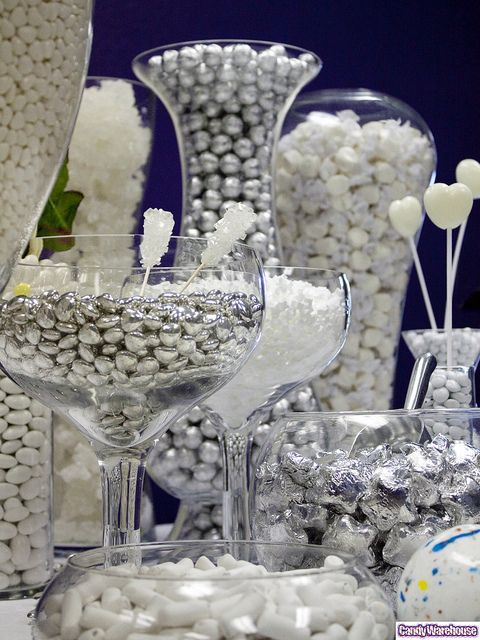 White Candy Buffet    White taffy, silver chocolate balls, giant jawbreakers, white rock candy, white champagne bubble gumdrops, white mints, and shiney silver hearts are featured in this exquisite candy buffet.: