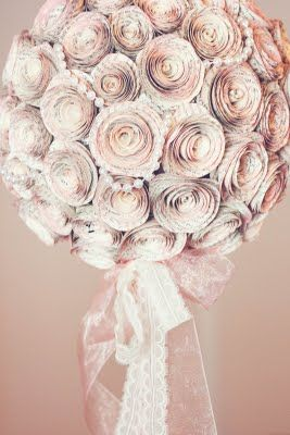 A pretty application of the paper roses. Great centerpiece idea for a shower, wedding, party, etc