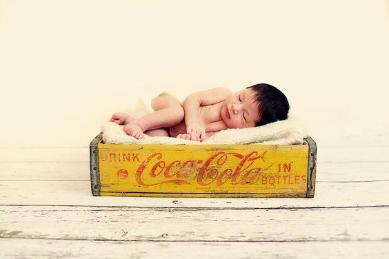 newborn in vintage coca cola crate