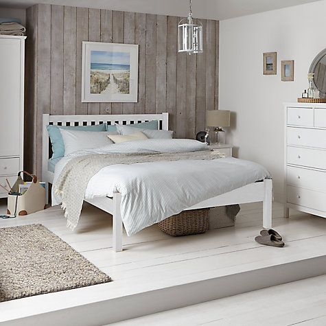 Pine bedding given a coastal feel in pale turquoise & white with glass lighting