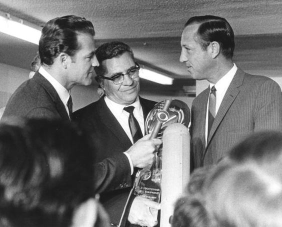 Super Bowl II:  CBS Sports' Frank Gifford interviews Pro Football Hall of Fame and Green Bay Packers head coach Vince Lombardi and NFL Commissioner Pete Rozelle after the Packers defeat of the Oakland Raiders, 33-14. (Getty Images)