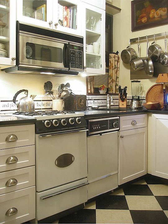 ... small, little NYC apartment, white appliances, little kitchen. Silver