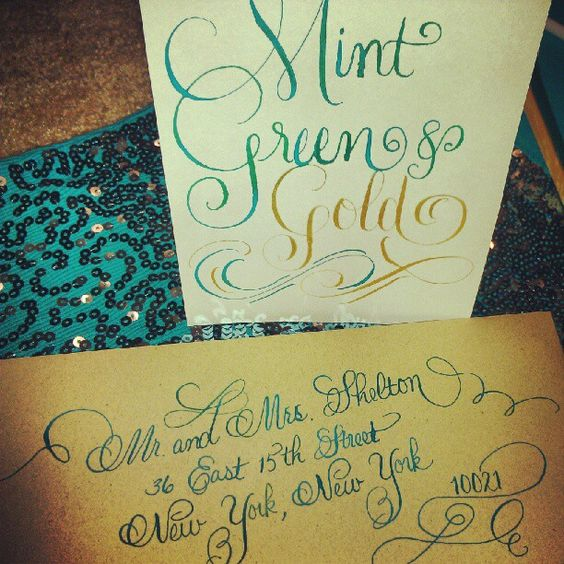 Mint green and gold calligraphy