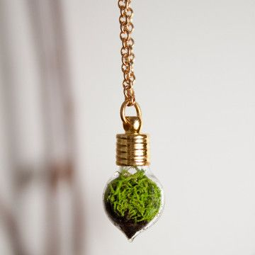 Love this! living terrarium necklacefrom Brooklyn-based jeweler With Roots. The Heart Necklace includes a heart-shaped pendant, alive with charcoal, soil and reindeer moss. Feed the tiny greenery with sunlight, which creates moisture to hydrate the plants. This is the perfect accessory for anyone who wants to wear nature close to the heart.
