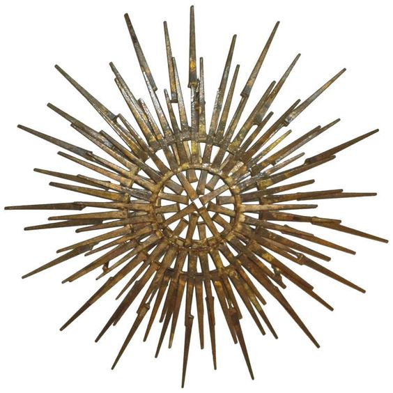 Brutalist Metal Sunburst Sculpture | From a unique collection of antique and modern decorative art at https://www.1stdibs.com/furniture/wall-decorations/decorative-art/