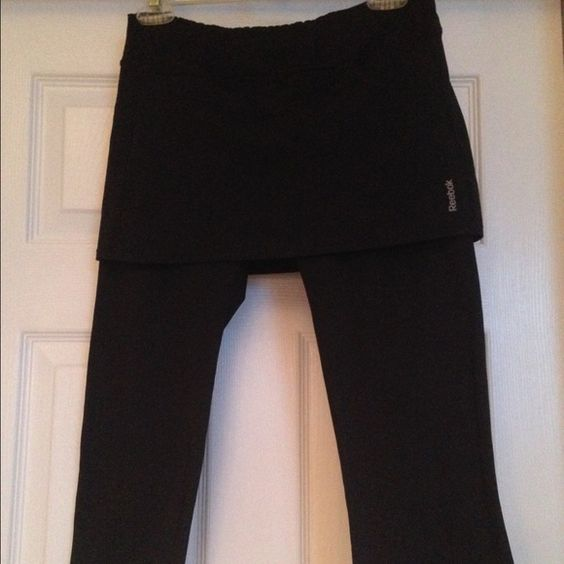 "Reebok Play Dry skort capris leggings These are so cute but I just do not wear them.  Great condition.  They are an XL but I normally wear a medium and they fit well.  I would say they work for ladies size small to medium.  Waist is 14"" lying flat.  Nice capri length 17-1/2"". Reebok Pants Capris"