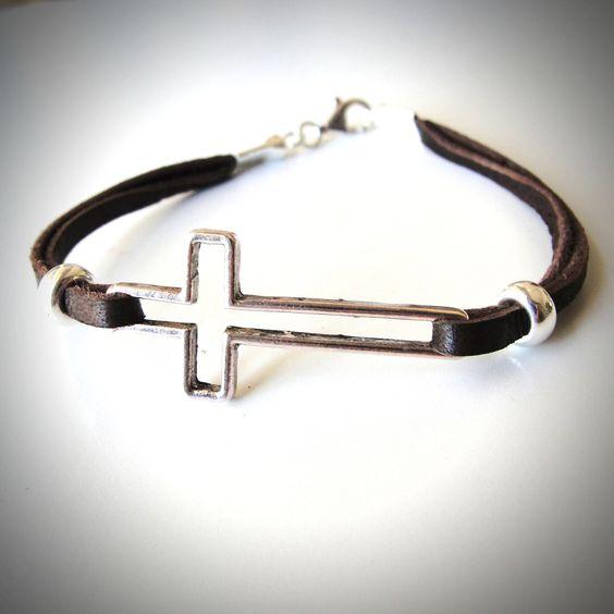 Silver Sideways Cross on Leather bracelet. From JewelryByMaeBee on Etsy.