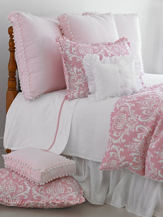 How cute is this bedding? Love the little poms and ruffles on the shams