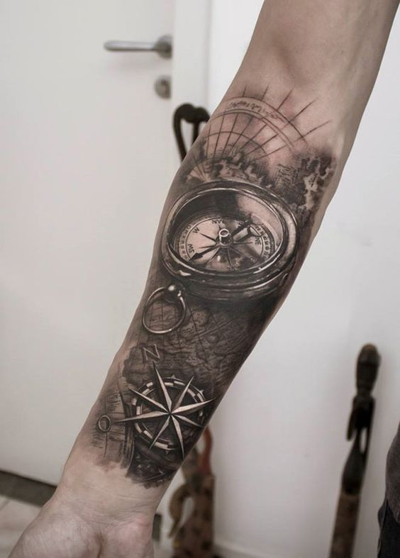 A well detailed and handsome looking sleeve tattoo. The details on the compass are simply stunning as well as how the map was drawn and the coordinates of the journey ahead. It makes you want to go on an adventure and into the seas.