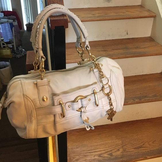 B Makowsky handbag BMakowsky cream leather purse with gold accents. Used a couple of times. In great condition. Has braided leather handle. Very soft leather. Dust bag included. The length is 12 3/4 inches, the width is 3 1/2 inches and the height is 8 inches.* b. makowsky Bags