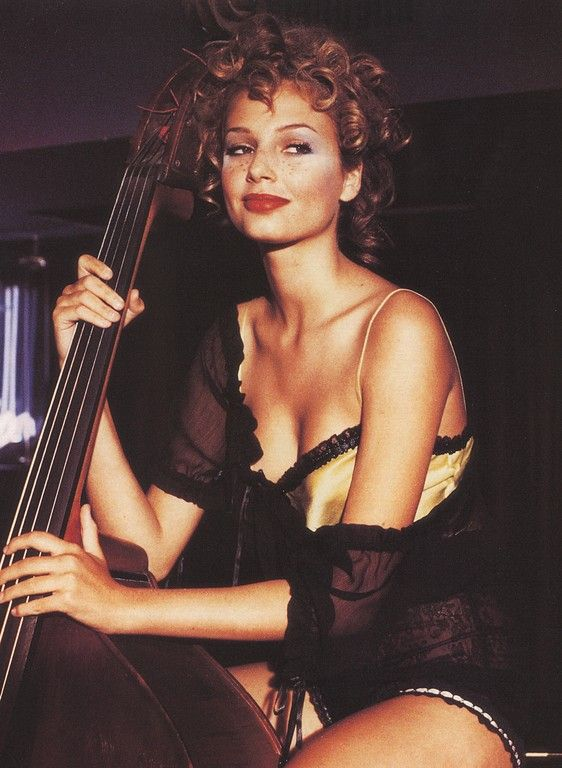 Bridget Hall playing the bass. Vogue Italia, 1994. Photographer: Pamela Hanson.Pamela Hanson is a New York-based photographer and film-maker renowned for her fashion photography that reflects a European sensibility - born in London, she grew up in Geneva and attended the American school in Lugano before moving to the United States.