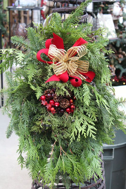 Christmas greens arrangement with touch of red berries