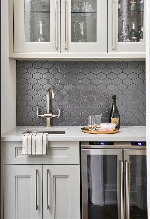 Light Gray And Black Butlers Pantry Boasts Black Honeycomb Backsplash Tiles Merge W Kitchen Backsplash Tile Designs Honeycomb Backsplash Backsplash Tile Design