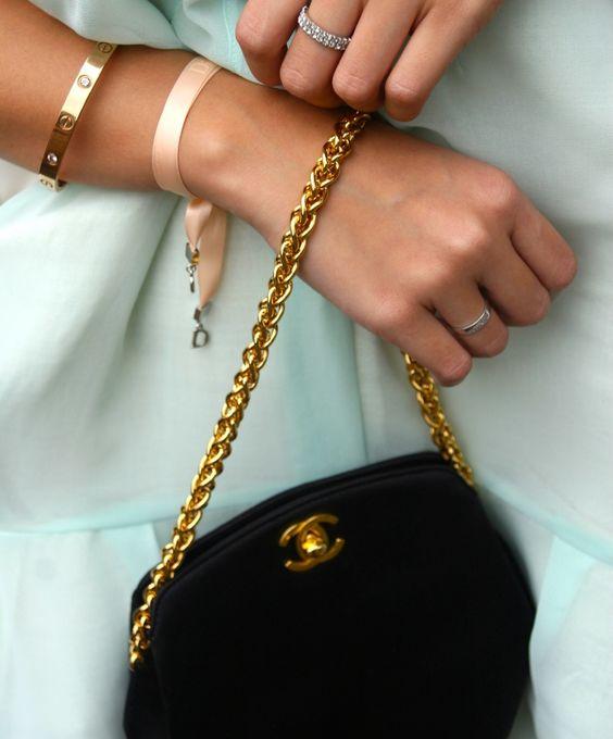 Cartier love bracelet and Dior ribbon bracelet with Chanel bag
