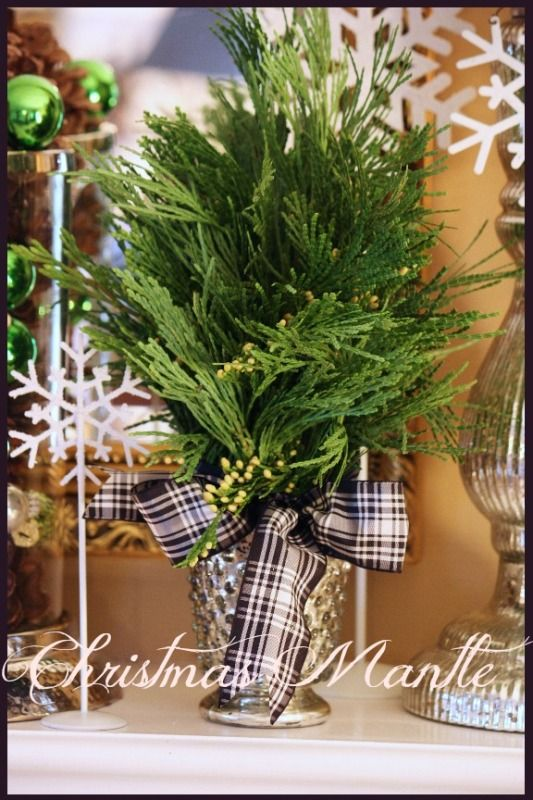 StoneGable's mantle decoration - black & white - this year's hot Christmas color combination? love the ribbon!