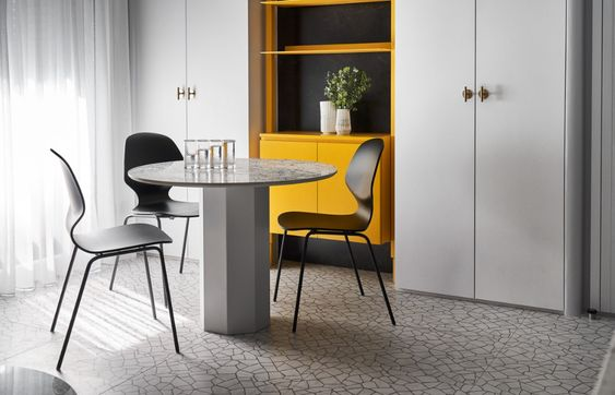 Confident Black, White & Yellow Interiors For Young Professionals