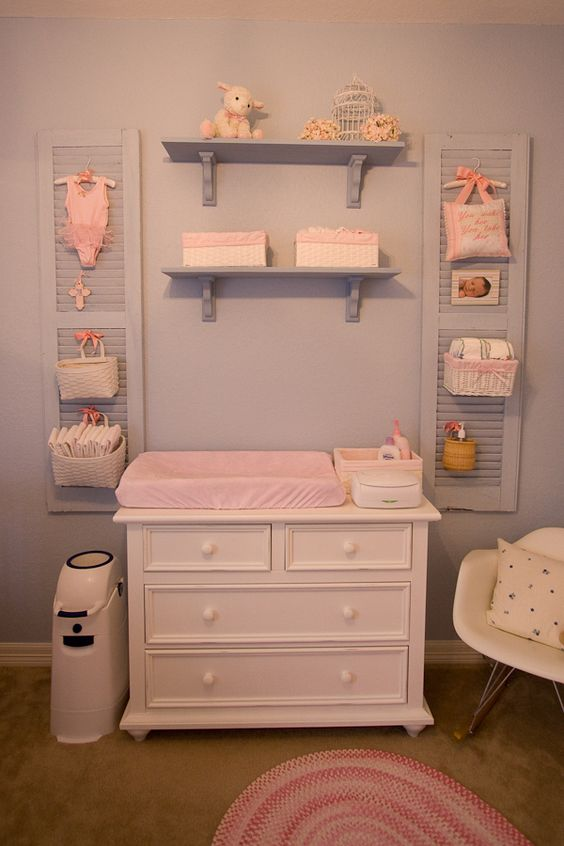 These are the shutters in my girls' nursery.  We've loved having the diaper storage off of the changer surface, but close by.  @Therese Göterheim Cornett I posted this for you!