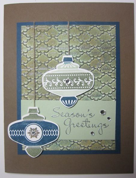 We love the gorgeous silver details on this great holiday card by Angie Leach.