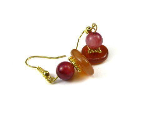 "Red Agate / Carnelian Semi Precious Gemstone with Amethyst Dye Shell Bead Dangle Earrings Creative Ventures Jewelry. $8.99. Red agate / carnelian semi precious gemstone heshi bead. Gold plated, fishhook, dangle earwires. Accented with amethyst dye shell bead. Accented with amethyst dye shell bead Earrings are 1/2 "" long by 1/2 "" wide. Designed and assembled in the USA"