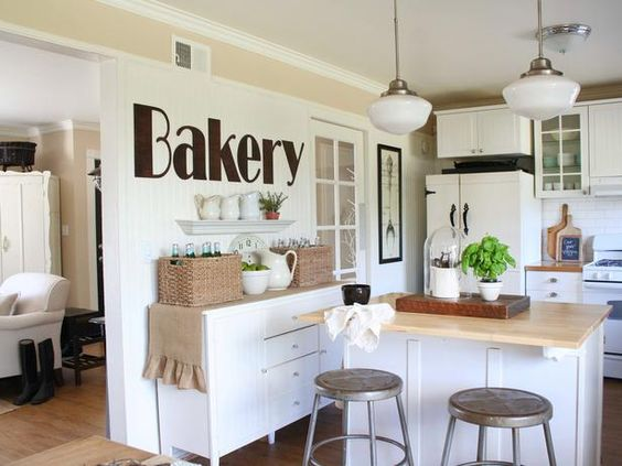 Vintage Elements  To bring some shabby chic style into the heart of the home, mix one part sunny, one part sophisticated, with a few hints of yesteryear. Vintage fixtures, hardware and accessories married with white or pastel-painted cabinets are the essence of today's shabby chic style kitchen. Photo courtesy of Jennifer Grey
