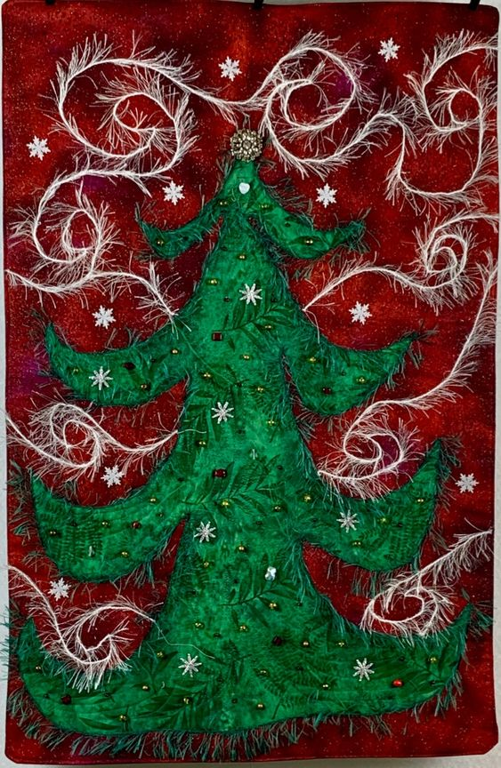 A fun experiment made years ago when I was trying out couching on my domestic machine. Inspired by the jewel on the top of the tree that was a piece of costume jewelry that my mother gave me. #experiencethequilt #couchingonquilts #couching #longarmquilting #artquilt #ETQ #Quilt #Quilting #Christmasquilt #Christmas