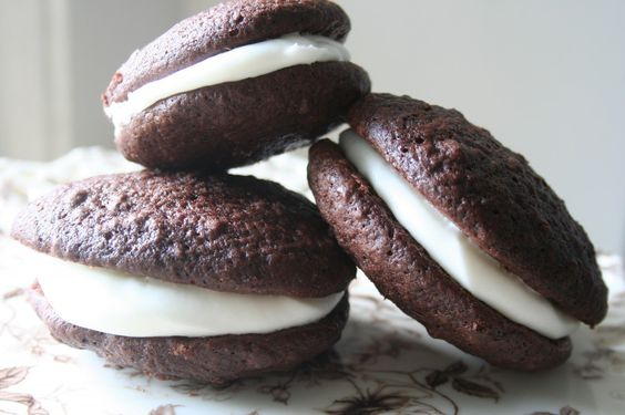 S'mores Whoopie Pies is a graham cracker cake cookie with chocolate ganache and a tasty marshmallow buttercream that perfectly compliments hot cocoa.