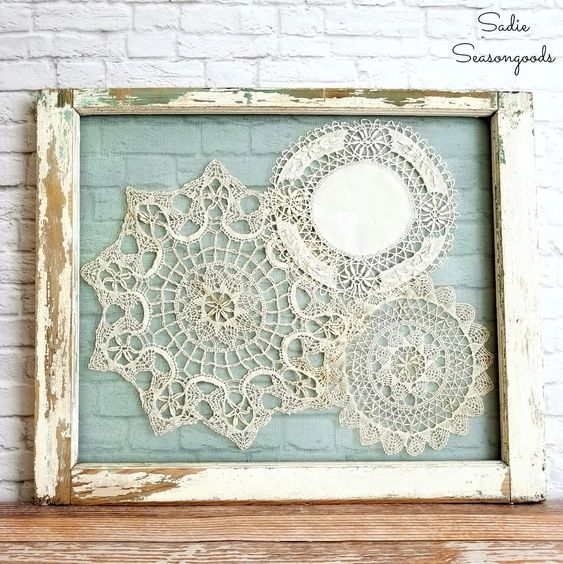 Create some gorgeous window frame decor by upcycling old windows and repurposing vintage crochet doilies for gorgeous DIY cottage style decor!