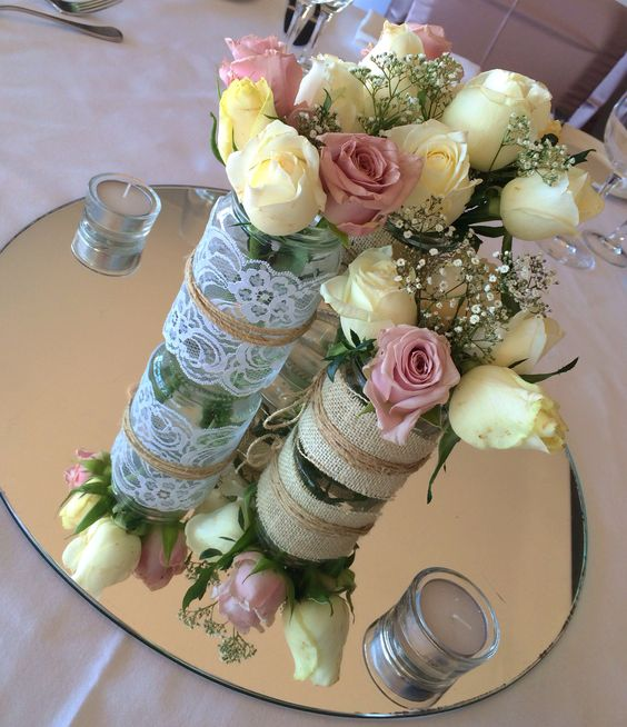 Vintage rises in lace wrapped vases. Thanks to @Beedazzled Events at The Surf Club Mooloolaba
