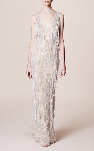 This **Marchesa** gown features a v-neckline and all over pearl and crystal fringe detailing.