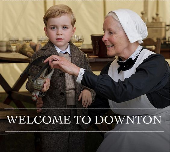George, the son of Lady Mary and Matthew. Good casting, he really looks like he could be the son of Matthew. Downton Abbey.