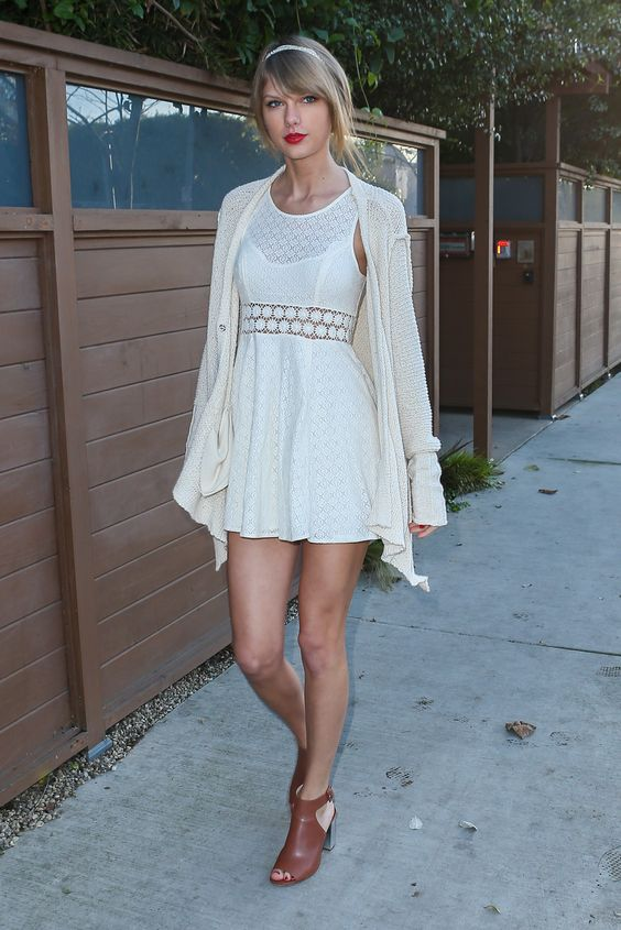 Taylor visiting a friend in Los Angeles on January 14, 2015 wearing a Free People dress and cardigan and Prada shoes.