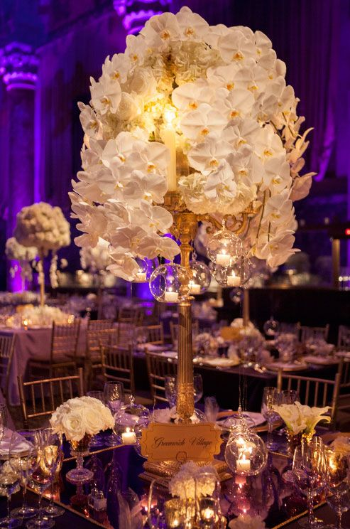 Tall centerpiece wedding lighting and reception table on