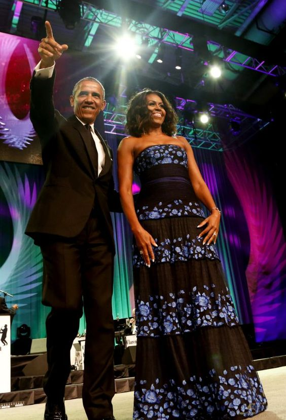 <p>Obama paid tribute to female leaders in civil rights and his wife made a statement in a black dress with blue flowers from Tadashi Shoji.<br /></p>