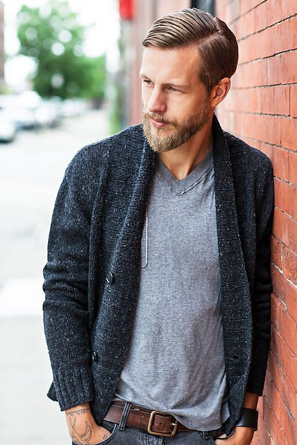 Pair a charcoal shawl cardigan and charcoal jeans to get a laid-back yet stylish look.  Shop this look for $144:  http://lookastic.com/men/looks/charcoal-shawl-cardigan-and-grey-v-neck-t-shirt-and-dark-brown-belt-and-charcoal-jeans/3838  — Charcoal Shawl Cardigan  — Grey V-neck T-shirt  — Dark Brown Leather Belt  — Charcoal Jeans