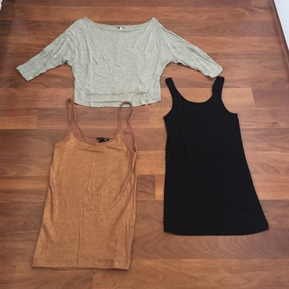 Express, H&M, Old Navy top bundle Express, H&M, Old Navy top bundle. Contains Express Crop off shoulder gray 3/4 length shirt size S, copper with glitter H&M tank size M, and black scoop neck Old Navy tank size S. H&M and Old Navy shirt are NWOT. Express shirt has some small stains on front. Express Tops Tank Tops