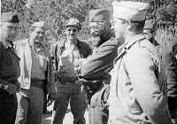 General Mihailovic with the representatives of the American military (from left to right): Colonel Robert McDowell (Ranger Mission), Captain George Muslin and Captain Nick Lalic (Halyard Mission).  Operation HALYARD (OSS, 1944)