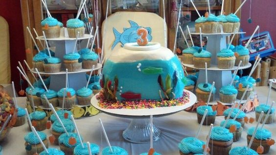 """Cake I did for my nephew's """"Goin' Fishin'"""" theme bday.  Fish bowl with cupcakes that had fishing poles."""