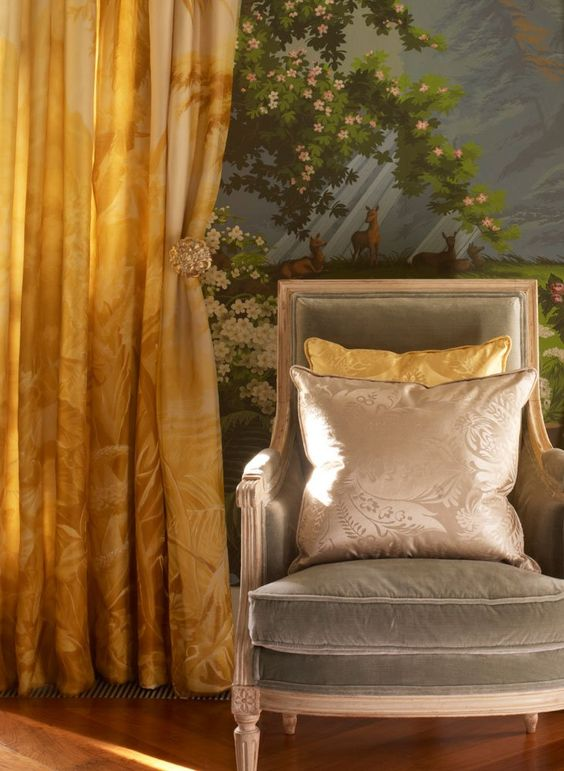 'L'Eden' silk organza curtain in full custom monochromatic design colours overlaid on Watery Sunshine Slub silk. 'Pineapple' silk damask cushions in Raw Silk and Watery Sunshine. Chair upholstered in Eucalyptus silk velvet.