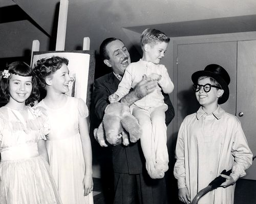 """To grow up will be an awfully big adventure."" (Not sure exactly when this was taken, but it looks like it must be Walt with the kids who modeled for Peter Pan.  Pretty Cool.)"