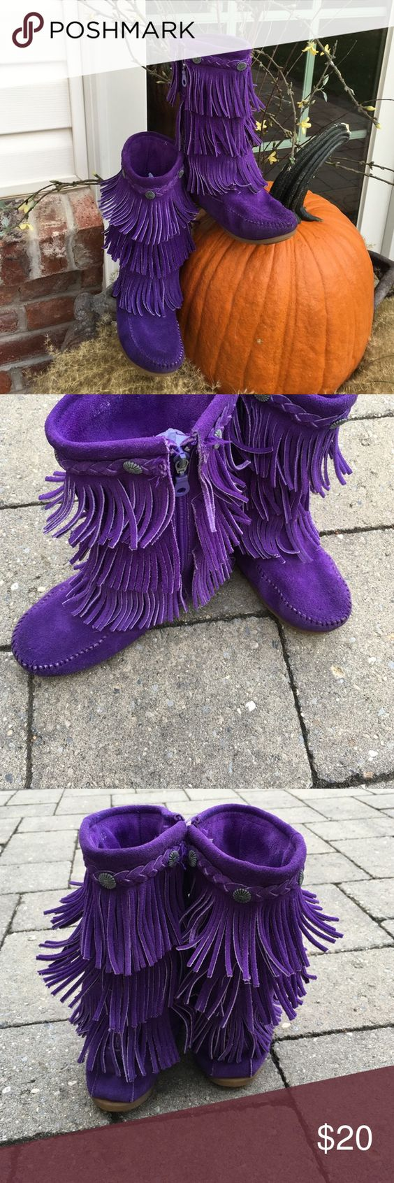 """Minnetonka Kid's Fringe Boot Three tiers of fringe cover the tall shaft of a flat suede boot, trimmed with whipstitching along the seams for subtle detail. Flower-shaped ornaments along the braided collar complete the stylish look. 7 1/2"""" boot shaft; 11"""" calf circumference (size 12). Side zip closure. Suede upper and lining/rubber sole. By Minnetonka; imported. Great condition except for some wear on the inner part near the bottom. See last photo. However not noticeable when wearing. Outer…"""