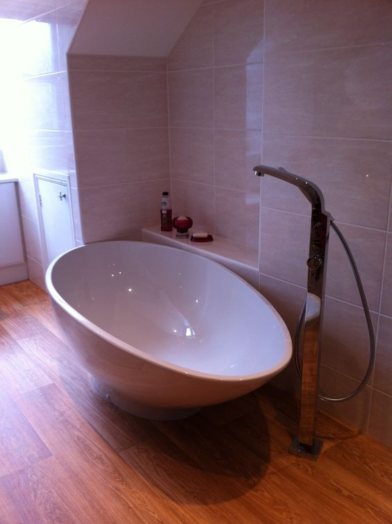 Egg shaped freestanding bath and tap