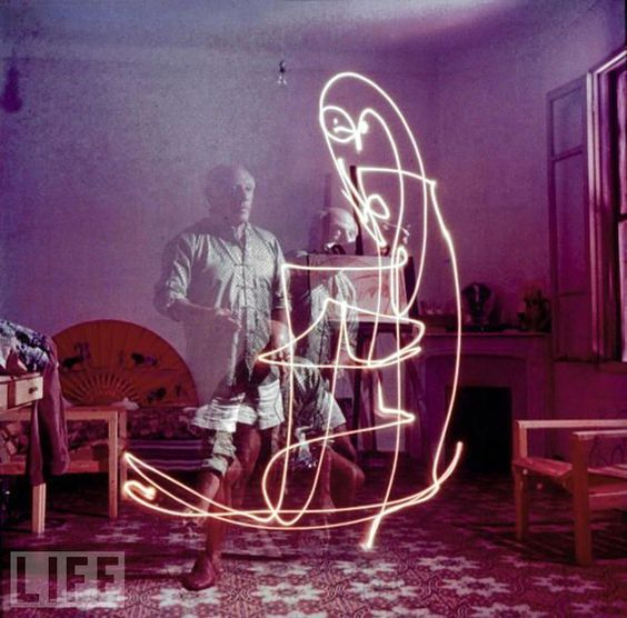 Picasso Drawing With Light  June 22nd, 2009    In 1949, LIFE photographer Gjon Mili visited Picasso in Vallauris, France. He showed Pablo some photographs of ice skaters with tiny lights affixed to their skates jumping in the dark. Picasso was immediately inspired, these photos were the result.